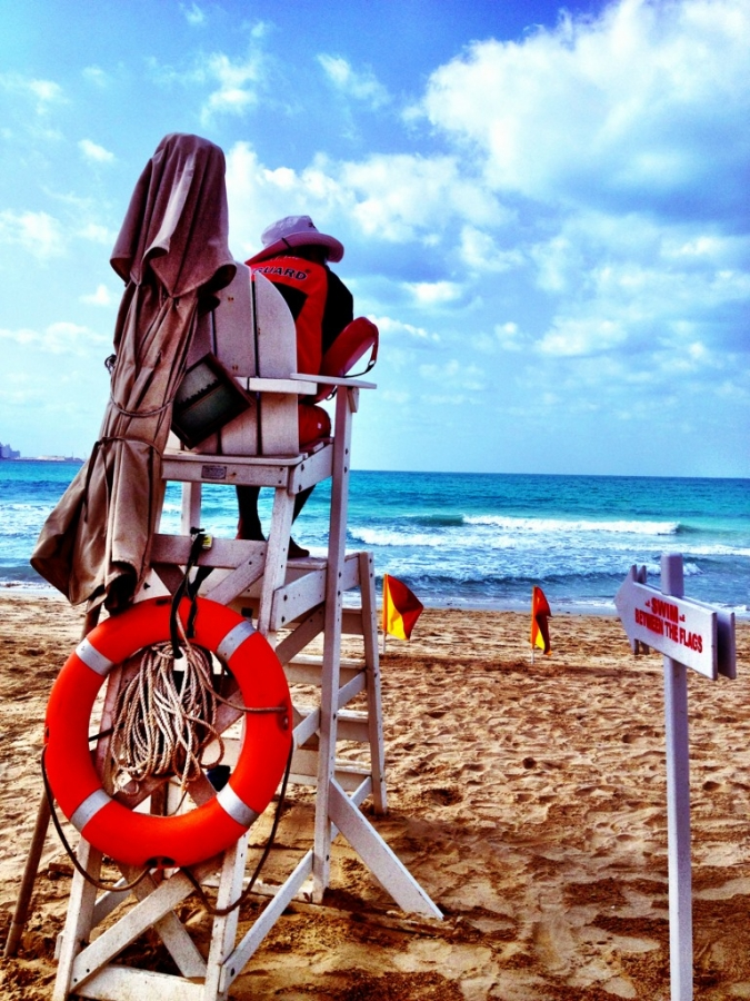 [Image: Image by @PhilipBloom - This lifeguard is taking NO chances with the choppy ocean today! :) on Propic]