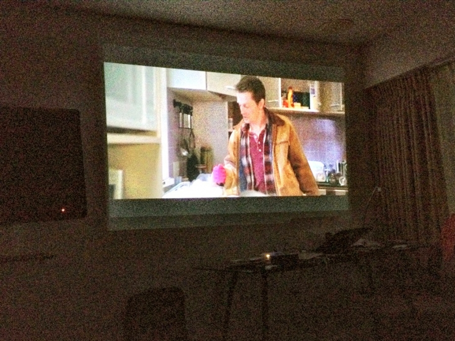 [Image: Image by @PhilipBloom - Watching an underrated movie on hotel room wall. Fantastic 10 foot HD image from the pico projector. Guess the film on Propic]