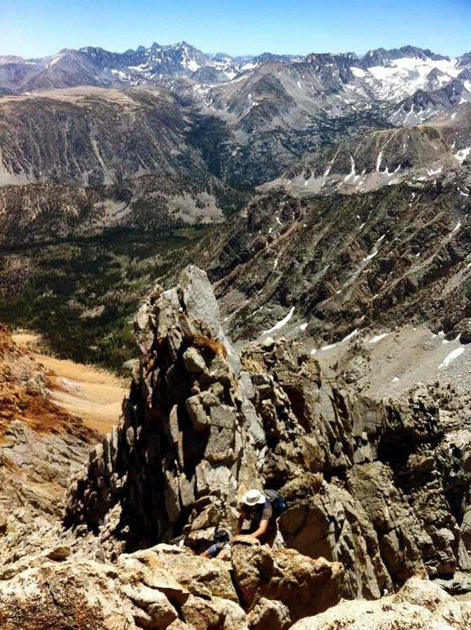 [Image: Image by @shawnreeder - Sitting on the summit of Mt Emerson w/  great friends. Here's @YosemiteSteve climbing up the ridge below the summit on Propic]