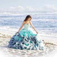 [Image: Quinceañera at the beach ]
