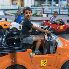 [Image: Nephew Racing Tiny Cars by Anand]